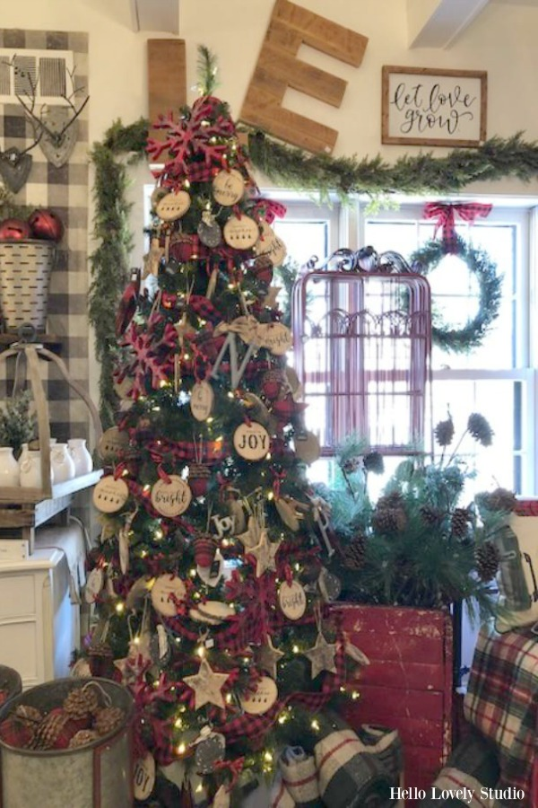 Farmhouse style Christmas tree decorated with wood slices at Urban Farmgirl. #farmhouse #christmasdecor
