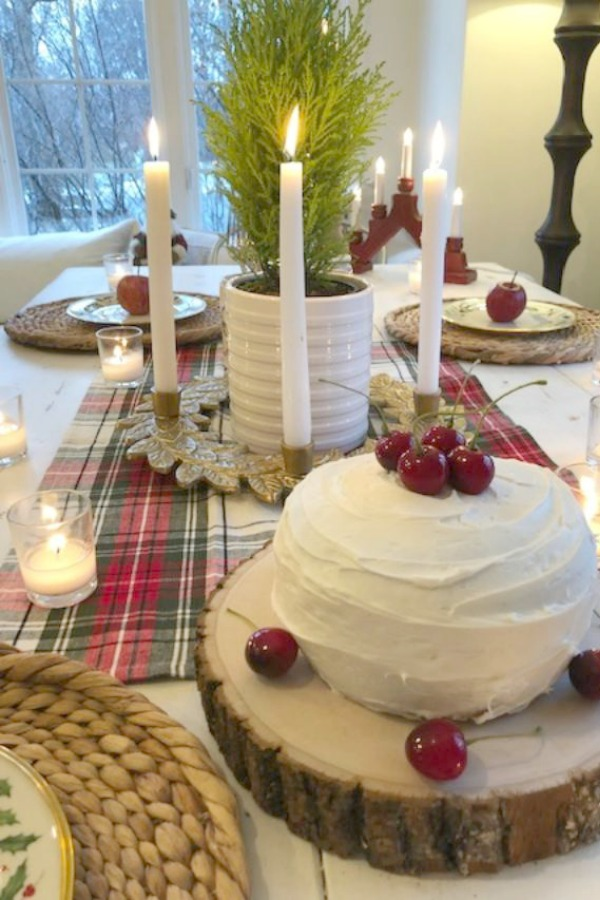 Tablescape with mini layer cake, cherries, and plaid for Christmas. Hello Lovely Studio.