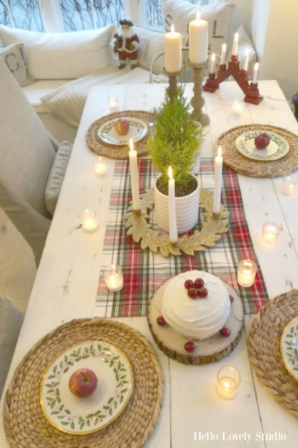 Scandinavian style and farmhouse touches at a breakfast table decorated simply with red accents for Christmas. Beautiful holiday decor inspiration from interior designers and bloggers. Come discover 28 Amazing Christmas Decorating Ideas! #christmasdecor #holidaydecorating