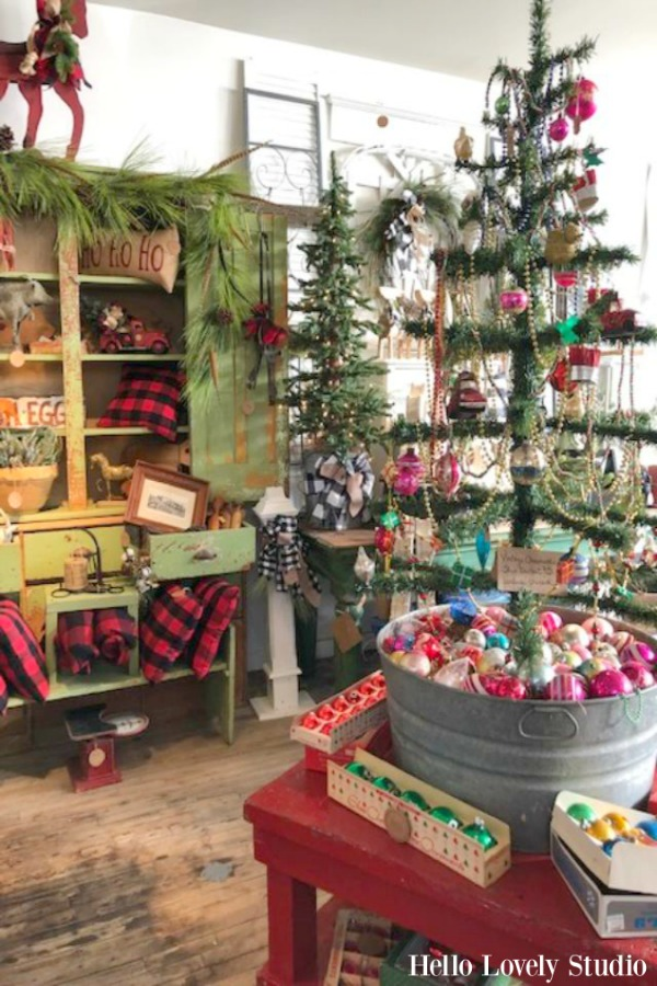 Vintage style Christmas decor with a tree in a galvanized tub and a gorgeous green primitive cabinet!