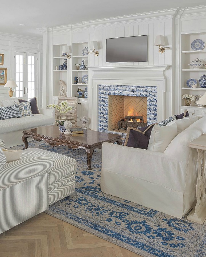 Gorgeous and sophisticated white and blue living room by The Fox Group. Come be inspired by Get the Look: Warm White Living Room Design With Unfussy Sophisticated Style...certainly soothing indeed.