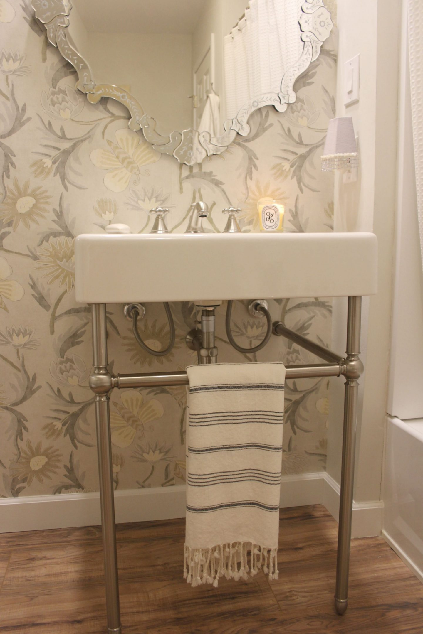 Thibaut Lizette wallpaper has a silvery background and gorgeous butterflies. This is our bathroom with a DXV Oak Hill modern farmhouse fireclay console sink. Hello Lovely Studio. #consolesink #hellolovelystudio