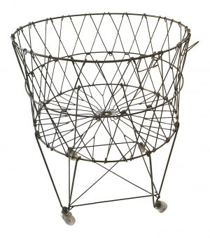 Vintage style French metal laundry basket with wheels.
