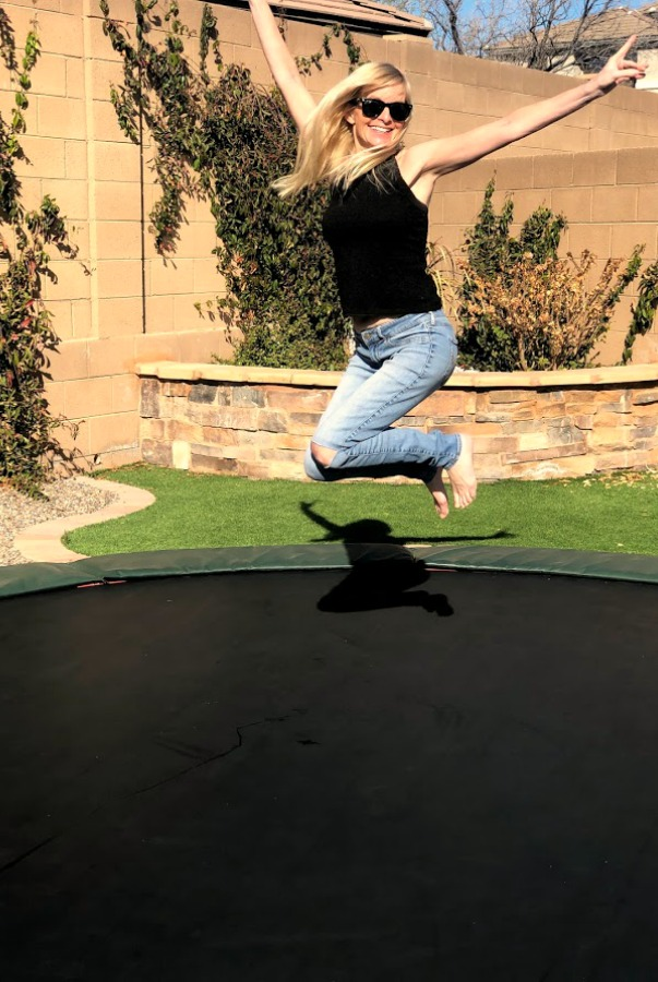 Michele of Hello Lovely Studio jumping on trampoline.
