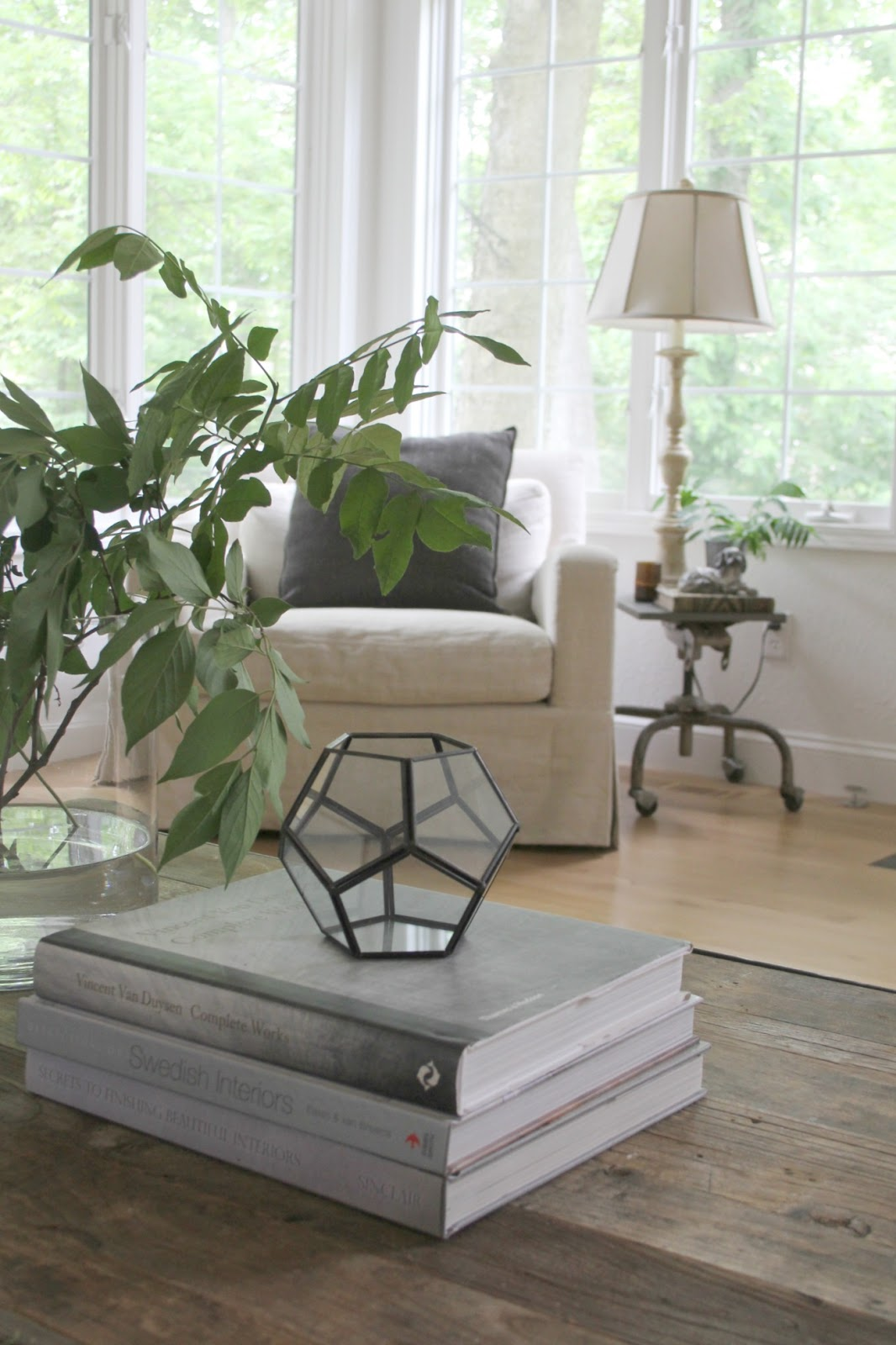 Belgian linen arm chair and industrial side table in my living room wih European country style - Hello Lovely Studio. Come be inspired by Get the Look: Warm White Living Room Design With Unfussy Sophisticated Style...certainly soothing indeed.