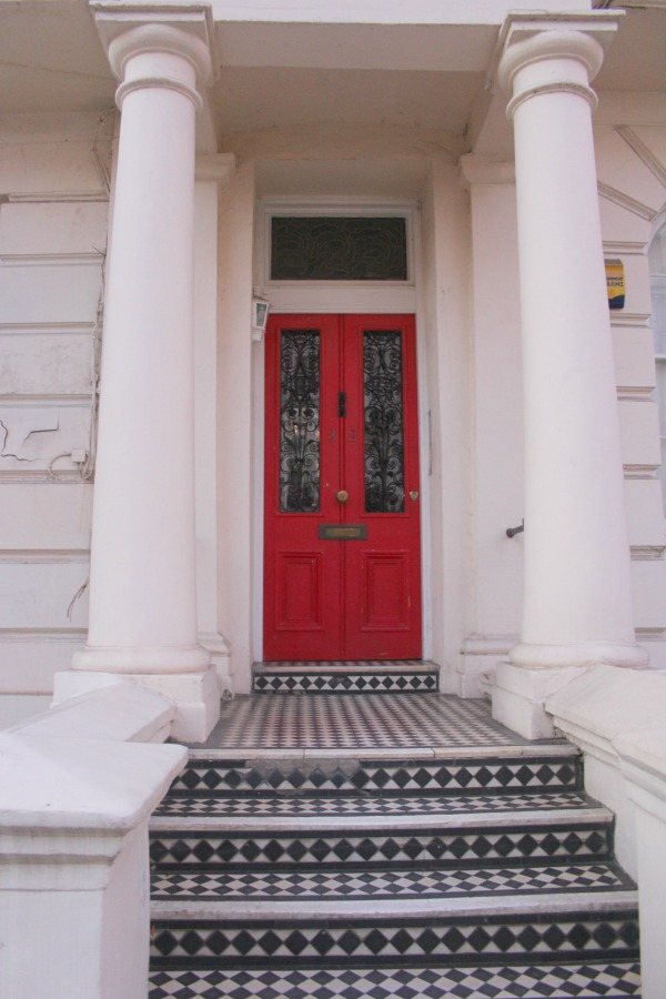 Vibrant red door in London. Notting Hill beauty, classic architecture, and inspiration from a London stroll by Hello Lovely Studio. Personal Reflections: What Does Greater Kindness to Yourself Look Like?