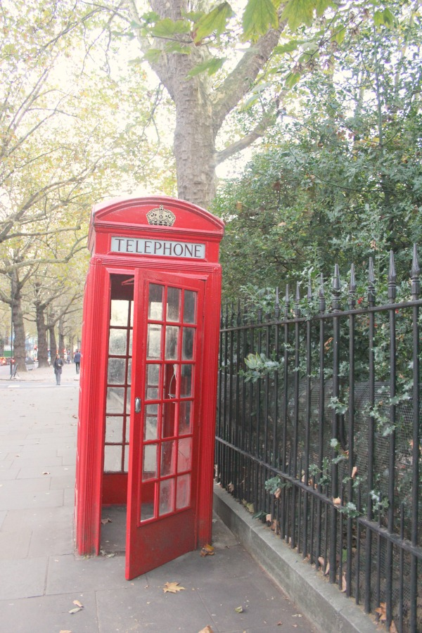 Classic British red telephone booth in London. Notting Hill beauty, classic architecture, and inspiration from a London stroll by Hello Lovely Studio. Personal Reflections: What Does Greater Kindness to Yourself Look Like?