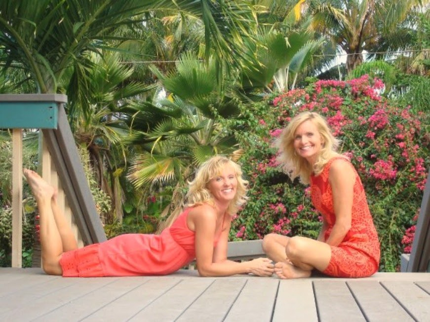 Sisters in coral sun dresses in Hawaii. Hello Lovely Studio.