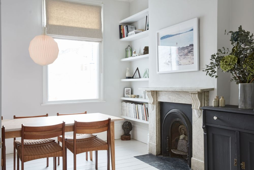 All white decor with simplicity, rustic design elements, and understated simplicity in a London Home offered by The Beach Studios. #whitedecor #housetour #simpledecor #interiordesign #vintagestyle #shabbychic