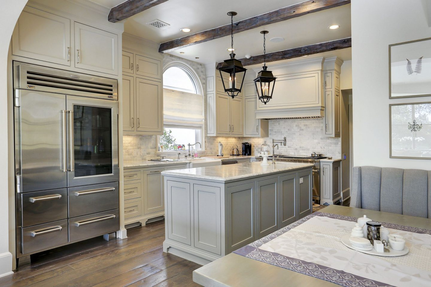 Grey and white French country kitchen in a Houston home by Thomas O'Neill. Come explore more Country French Decor Ideas from luxurious and grand homes.