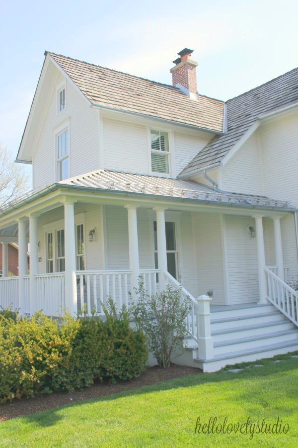 Beautiful white historic farmhouse exterior. Hello Lovely Studio. #farmhouse #houseexterior #wraparoundporch