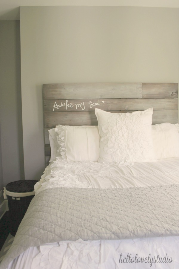 Beautiful handmade rustic plank headboard inscribed with AWAKE MY SOUL. A modern farmhouse bedroom with romantic white bedding. Hello Lovely Studio.