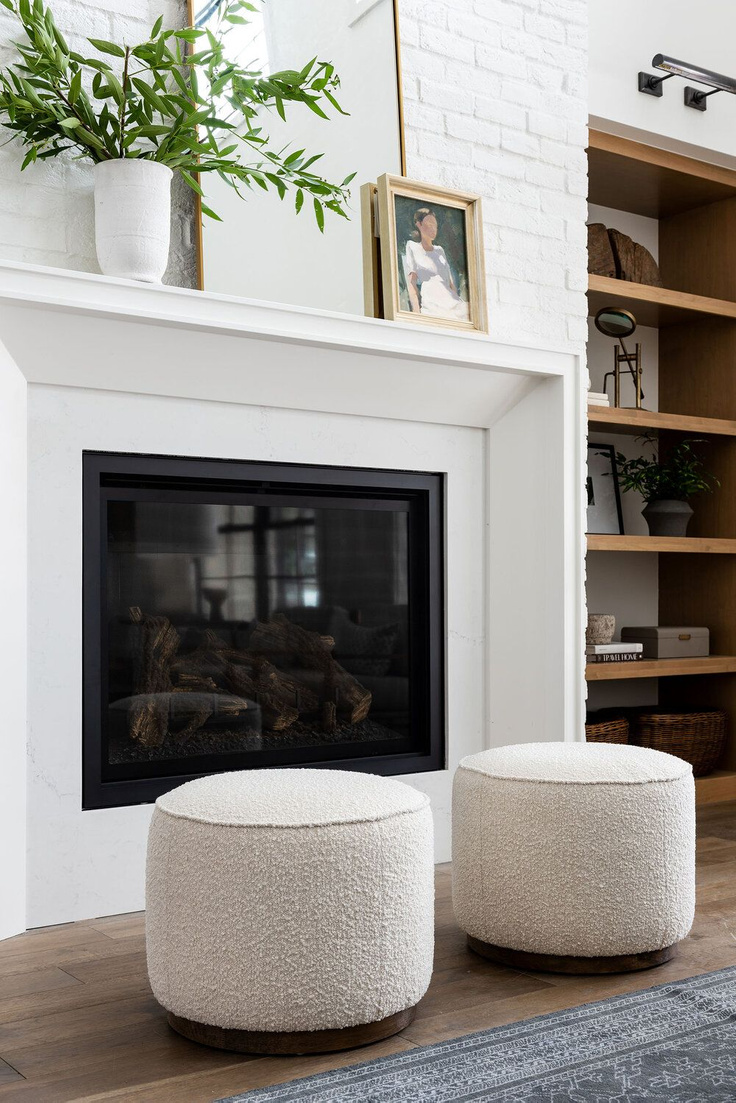Modern rustic great room with white painted brick chimney, natural wood accents, and warm laid back style. #studiomcgee #livingroom #greatroom #beckhamproject #modernrustic