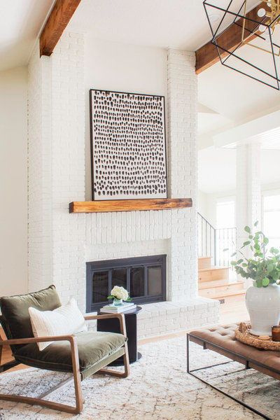 Black framed art on rustic wood mantel in a modern rustic living room designed by Scout & Nimble. #modernrustic #livingrooms #neutraldecor