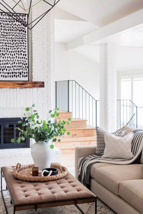 Scout & Nimble designed living room with white brick fireplace and modern rustic style. #modernrustic #livingroom #warmmodern