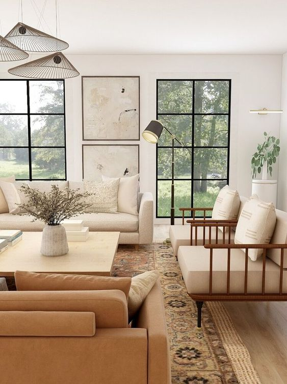 Warm modern rustic living room with soft neutrals and steel windows - Sabina Interiors. #modernrustic #livingrooms #modernluxe