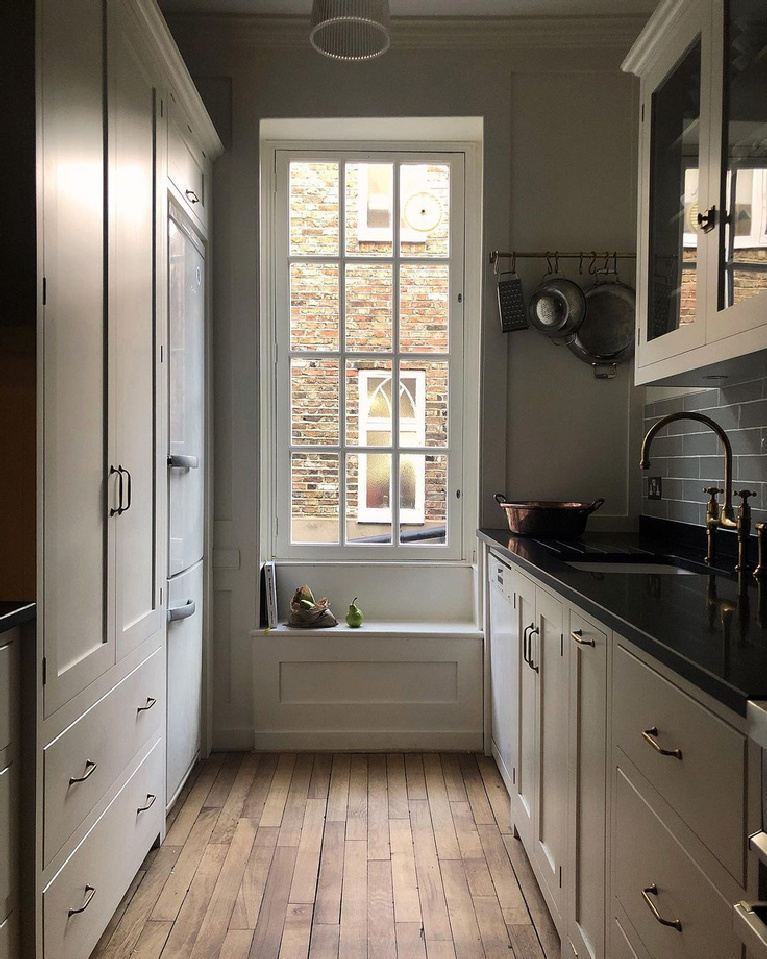 Classic English country bespoke kitchen by deVOL with tiny window seat and galley style. Find more ethereal European country kitchen moments in this collection!