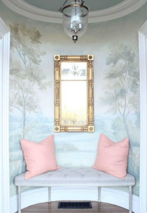 Timeless and tranquil landscape wallpaper mural with blues and greens in entry with bench. Design by Morrissey Saypol. Mural by Susan Harter. #wallpaper #mural #landscape #handpainted