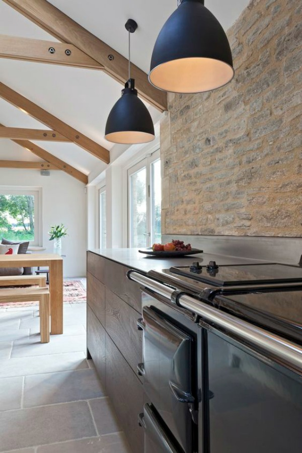 Bespoke kitchen design with urban rustic style in Cotswolds, Gloucesterhshire by Artichoke. Distressed oak, stainless steel, and Calacatta Oro marble star in the design ingredients.