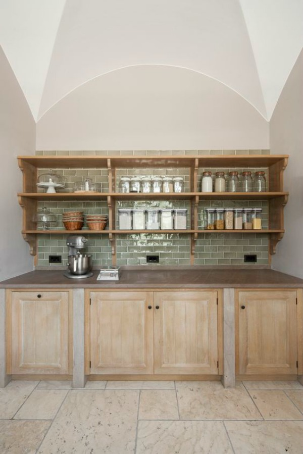 Bespoke pantry and scullery design by Artichoke for a villa in Tuscany. This scullery off the main kitchen features glazed green tile backsplash, plate racks, oak cabinetry, and magnificent arthitecture.