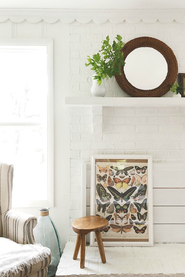 Vintage style butterfly print against white shiplap in modern farmhouse.