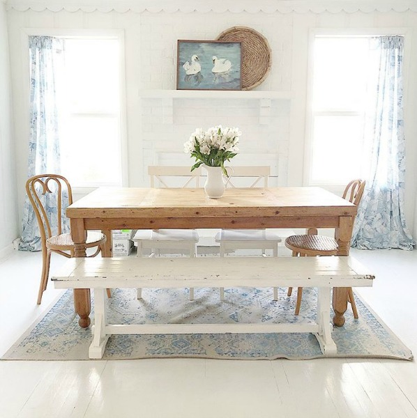 Soft blue and white accents in a modern farmhouse dining room.