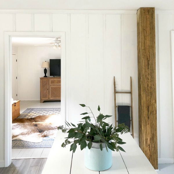 Board and batten wall treatment in modern farmhouse style room.