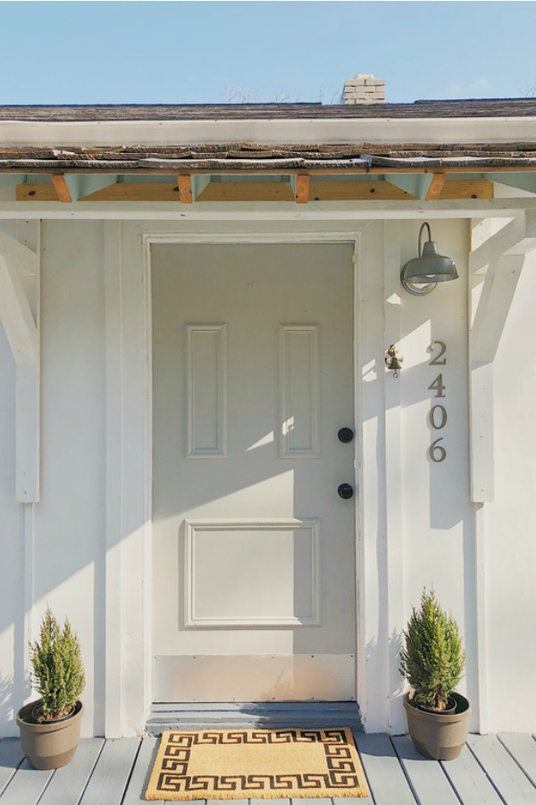 Charming cottage front door and board and batten siding.