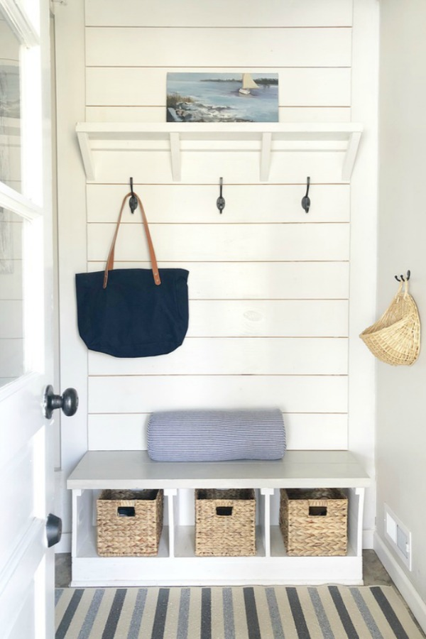 Shiplap on mud room entry with bench.
