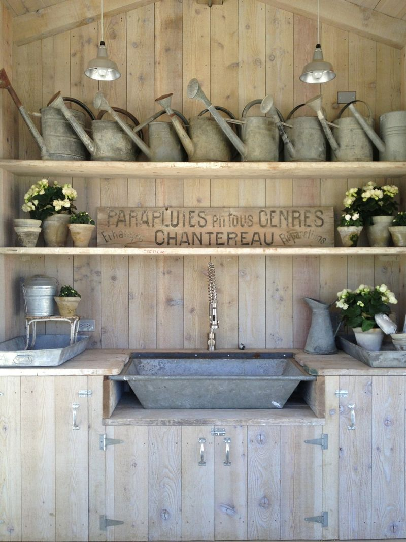 Brooke Giannetti's chicken coop and gardening shed at Patina Farm. See more rustic elegant French farmhouse design ideas and decor inspiration. #frenchfarmhouse #interiordesign #frenchcountry