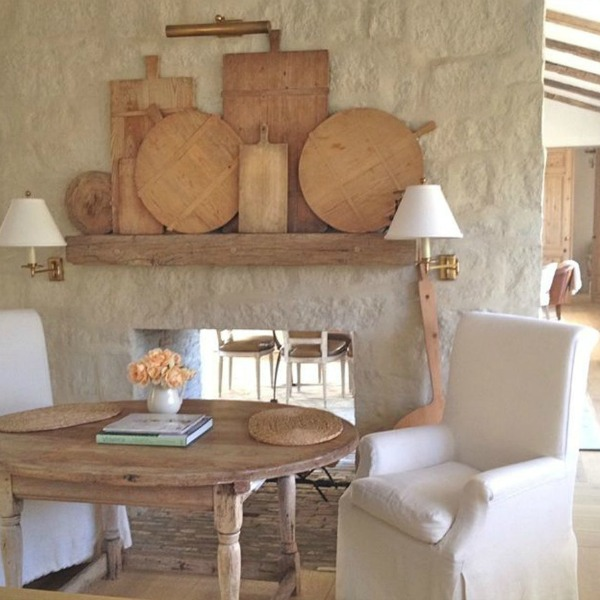 French farmhouse limestone fireplace and antiques in Patina Farm Kitchen - Giannetti Home. #frenchfarmhouse #fireplace #patinafarm #giannettihome #interiordesign #europeanfarmhouse #modernfarmhouse #limestone
