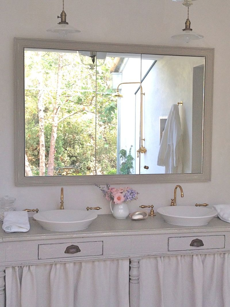 Patina Farm master bathroom with repurposed antique vanity - Giannetti Home. Pale and Lovely European Country White Interiors to Inspire with photo gallery. #interiordesign #frenchcountry