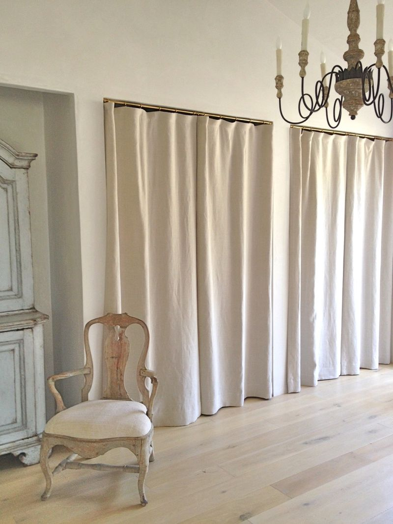 Linen drapery panels in lieu of closet doors at Patina Farm in master bedroom.