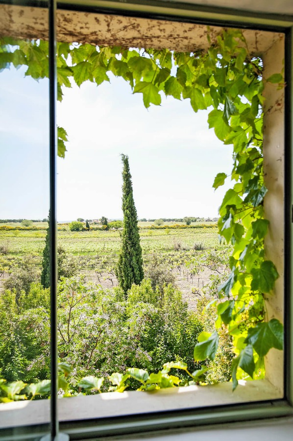 French countryside view. Provence dreams are made of these! Come tour French Farmhouse Design: Provence Villa Photos in a story with rustic decor, Country French charm, and South of France beauty! #frenchfarmhouse #interiordesign #housetour #frenchcountry #provence