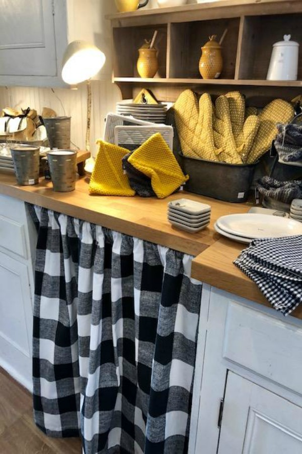 Accents of yellow and black on a country kitchen counter with farmhouse decor. Photo by Hello Lovely Studio. #urbanfarmgirl