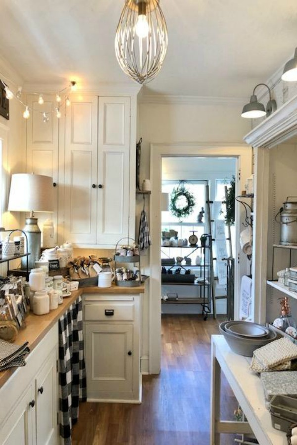 Farmhouse kitchen with white cabinets and black and white decor accents. #urbanfarmgirl