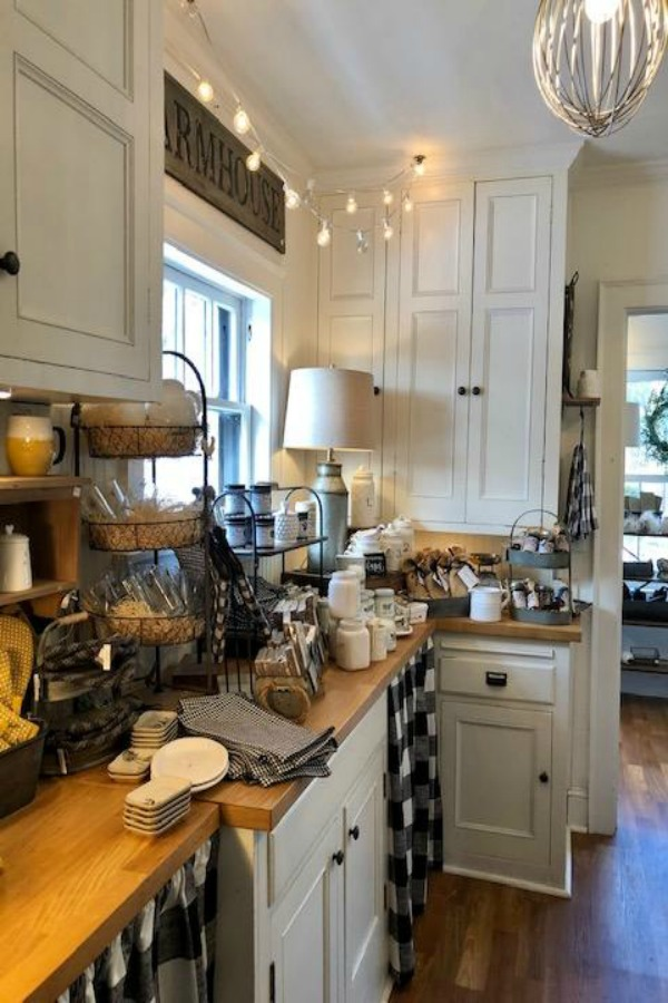 Farmhouse kitchen decor and black and white check accents in a country kitchen. #urbanfarmgirl