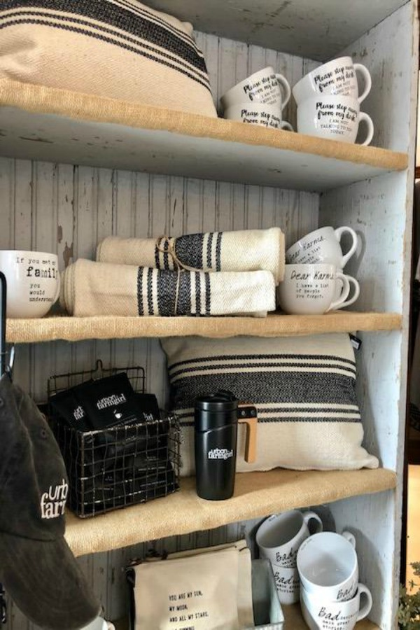Rustic country shelves with beadboard backing and farmhouse decor at Urban Farmgirl. Photo by Hello Lovely Studio.