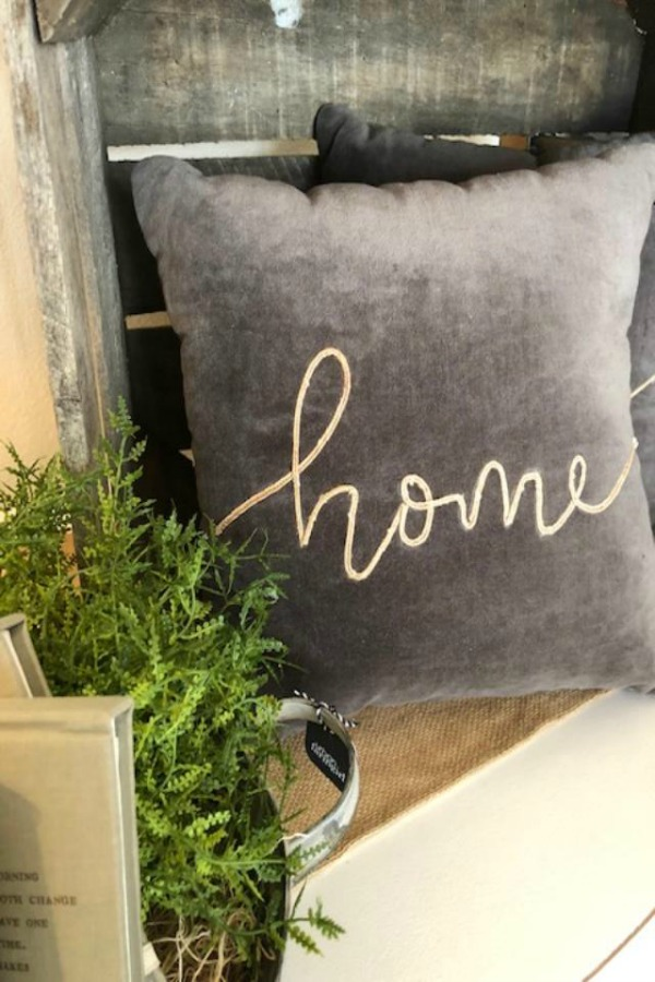 Grey velvet pillow with 'home' embroidery at Urban Farmgirl.
