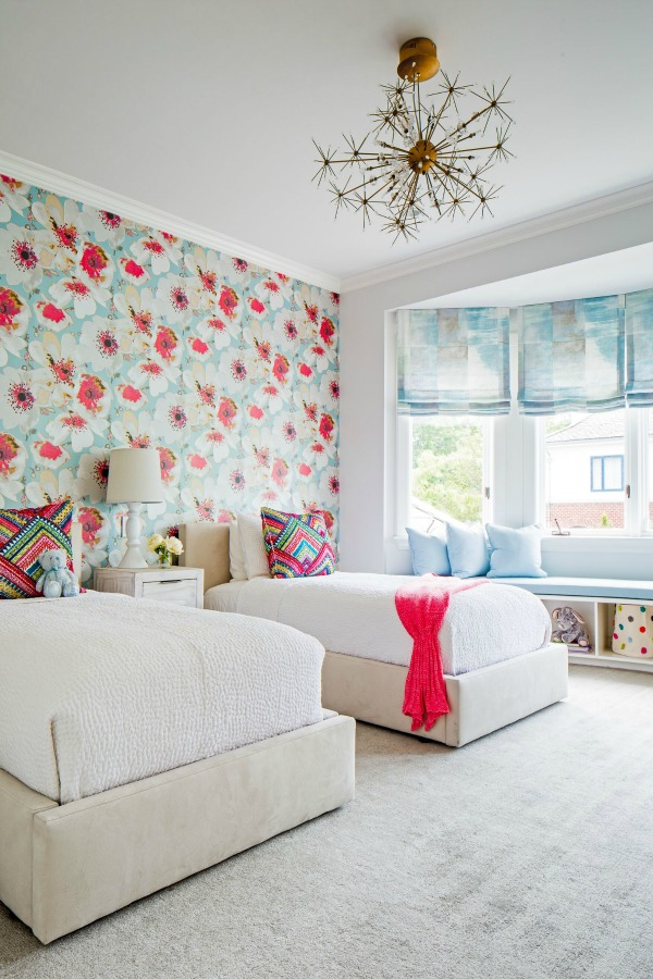 Vibrant and chic, poppies and turquoise are cheerful design elements in a kids bedroom by Ike Kligerman Barkley.