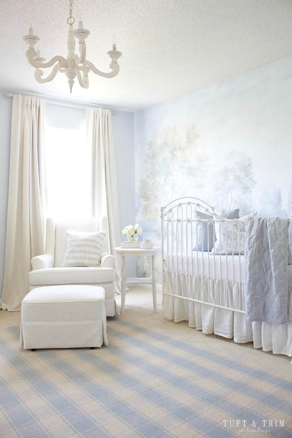 Magnificent landscape mural wallpaper in nursery designed by Tuft & Trim made from original painting by Susan Harter. Muted and sophisticated colors in this beautifully inspiring interior design. #mural #interiordesign #timeless #ethereal #serenedecor #paintedmural #wallpaper