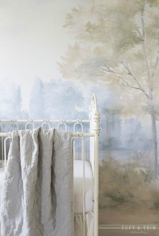 Detail of a magnificent landscape mural wallpaper in a nursery designed by Tufty & Trim. Mural is made from an original painting by Susan Harter. Muted and sophisticated colors in this beautifully inspiring interior design. #mural #interiordesign #timeless #ethereal #serenedecor #paintedmural #wallpaper
