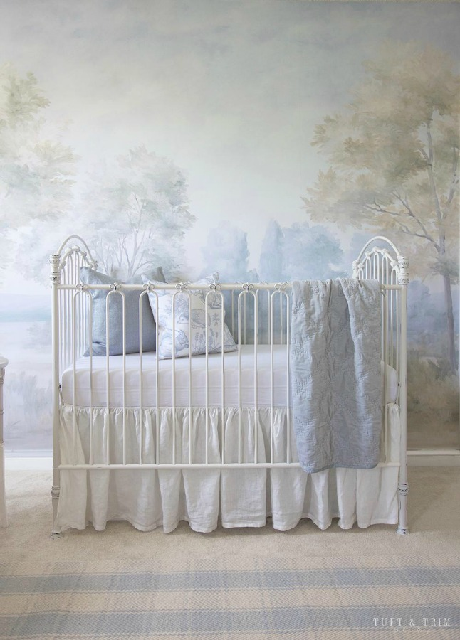 Magnificent landscape mural wallpaper in a nursery designed by Tuft & Trim, made from original painting by Susan Harter. Muted and sophisticated colors in this beautifully inspiring interior design. #mural #interiordesign #timeless #ethereal #serenedecor #paintedmural #wallpaper