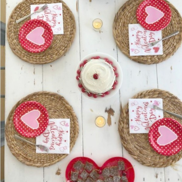Vintage Valentine Decorations & Layer Cake. Come find simple inspiration for EASY, old fashioned, heart and love themed ideas like this simple layer cake with cherry lollipops and vintage cards on Hello Lovely Studio. #valentinesday #decorations #tablescape #layercake #vintagevalentinecards