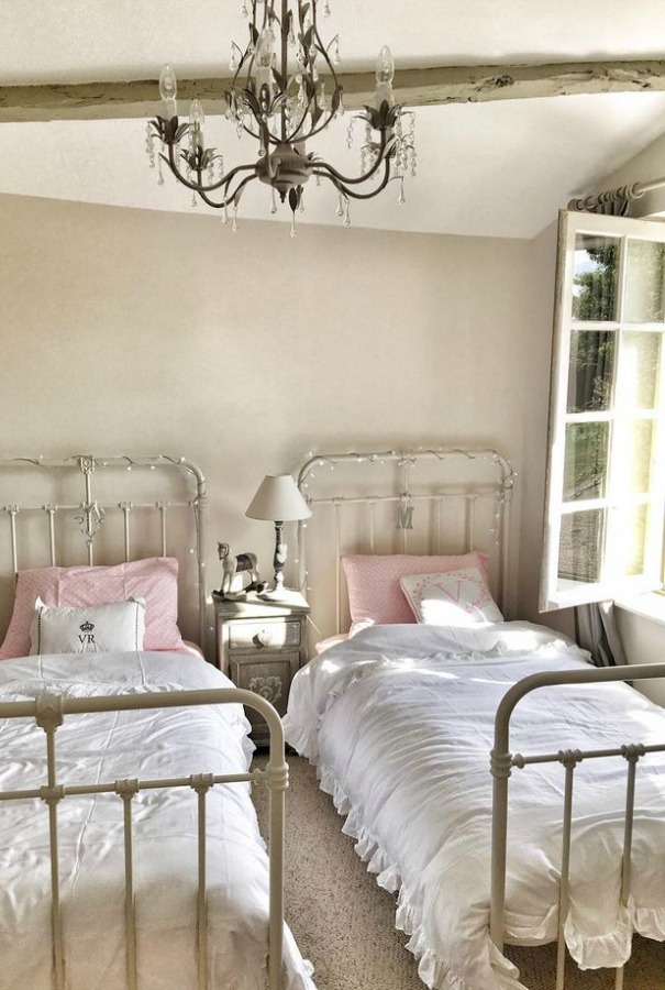 French farmhouse kids bedroom with twin metal vintage beds and walls painted Farrow & Ball Strong White.