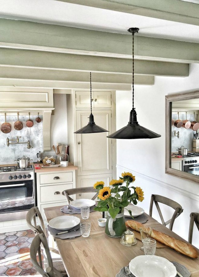 Rustic French farmhouse kitchen by Vivi et Margot. See more rustic elegant French farmhouse design ideas and decor inspiration. #frenchfarmhouse #interiordesign #frenchcountry