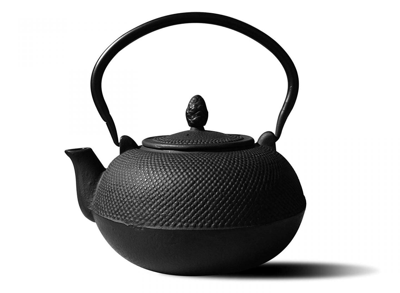 Black cast iron teapot.