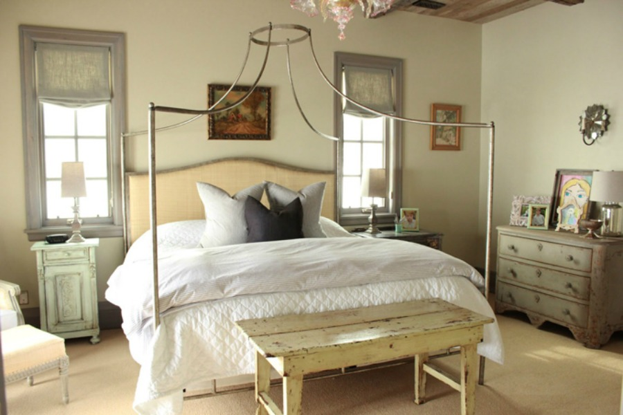 Lovely French country bedroom with blues and greens and magnificent bed by Oly Studio. Design by Decor de Provence.