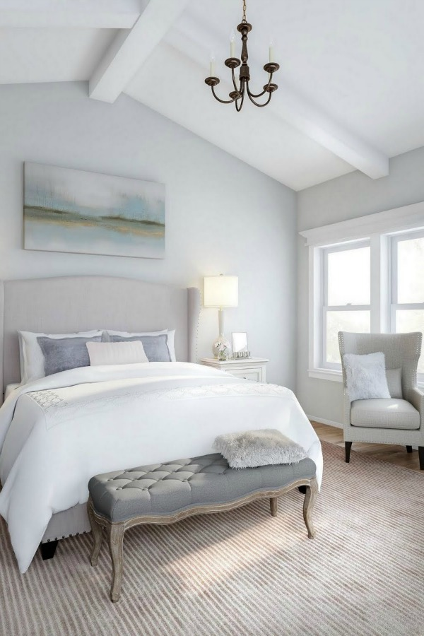 Timeless and Tranquil Bedroom Decor with blue grey walls, wingback bed, and French inspired accents. Get the look on Hello Lovely Studio!