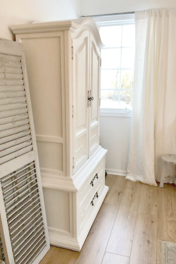 White armoire and rustic shutters painted Annie Sloan Paris Gray by Hello Lovely Studio.